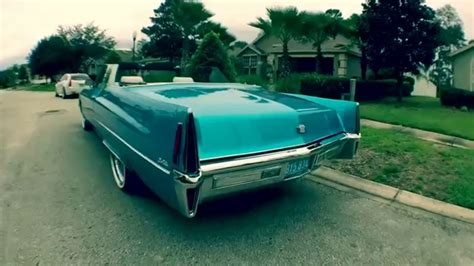 """1970 Cadillac Deville convertible on 22"""" Dayton's & Vogues"""